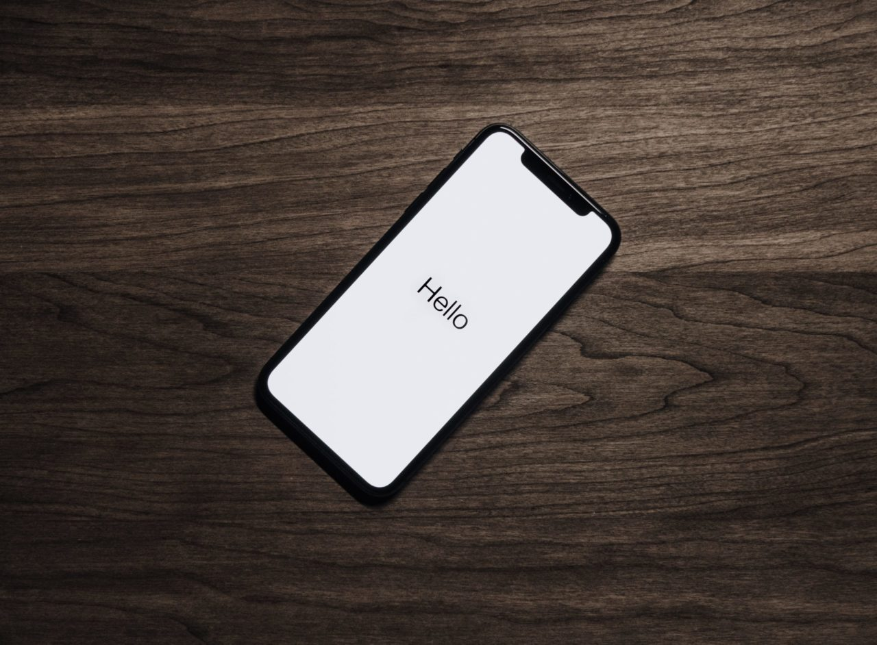 black-iphone-7-on-brown-table - deyco consulting